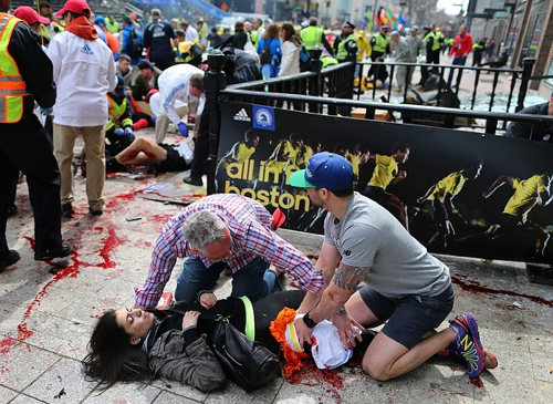 2 Men Help Woman Boston Bombing