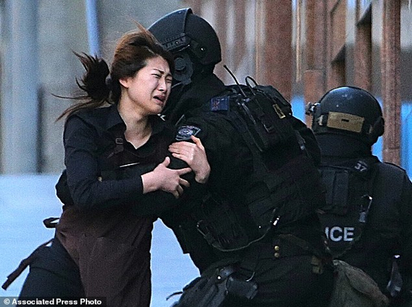 A Hostage Runs To An Armed Tactical Response Police Officers For-A-12 1418749507816