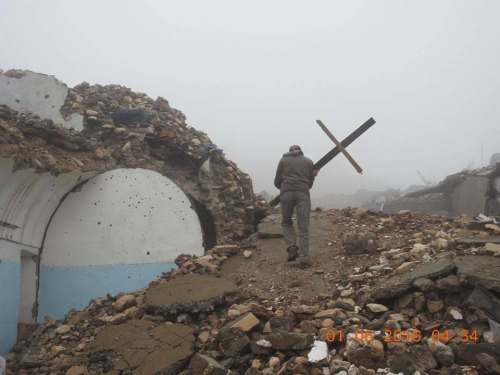 Yazidi Restores Cross