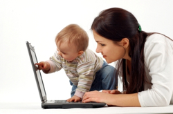 Mom-With-Baby-And-Computer