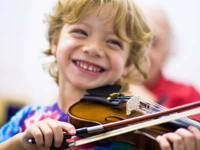 Smiling-Child-Plays-Violin