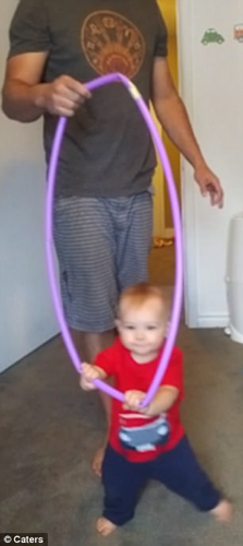 Tall Parents Hulahoop Toddlers