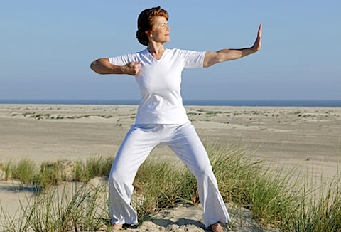 _woman_doing_tai_chi_on_beach.jpg