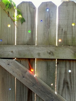 Use-Marbles-To-Fill-Fence-Holes