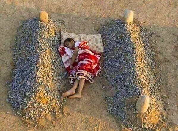 Syrian Child Sleeps Parents Grave